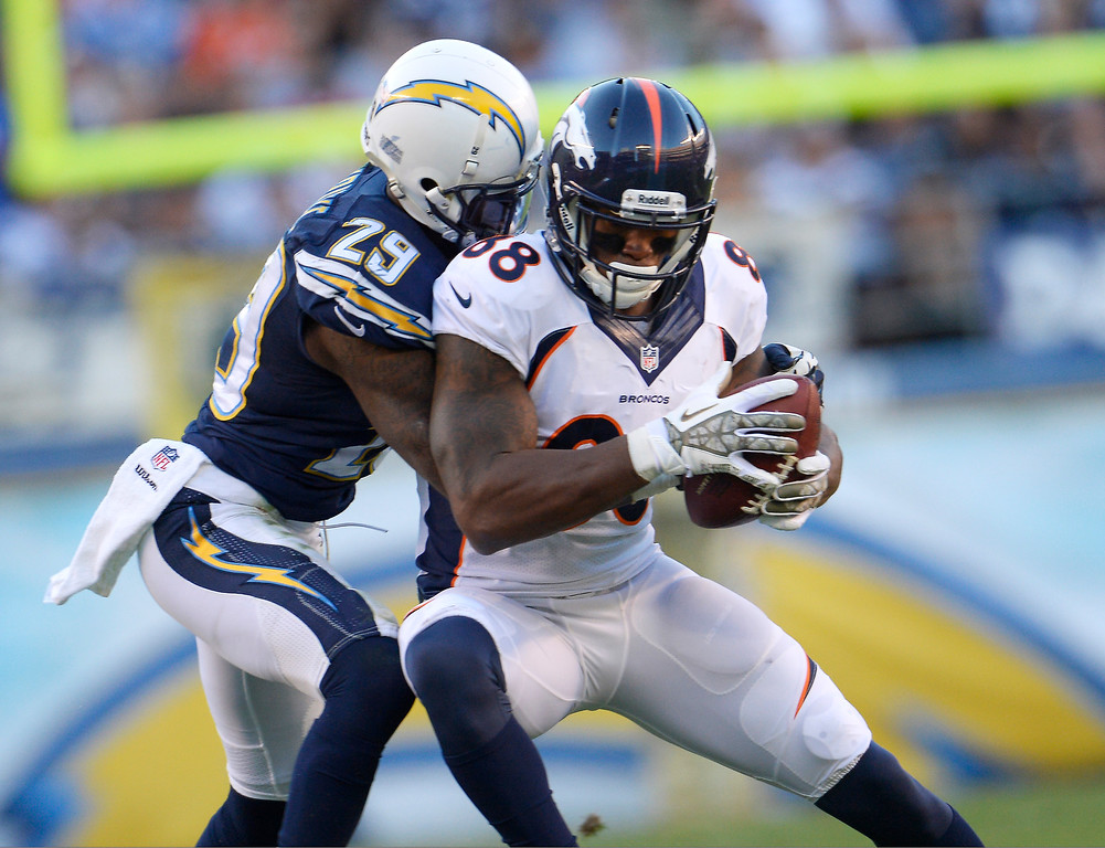 . Cornerback Shareece Wright #29 of the San Diego Chargers gets to wide receiver Demaryius Thomas #88 of the Denver Broncos as he pulls in a pass in the second half at Qualcomm Stadium November 10, 2013 San Diego, CA. (Photo By Joe Amon/The Denver Post)