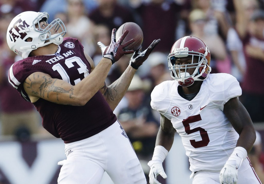 . <p><b>7. Tampa Bay: Mike Evans, WR, Texas A&M. </b> <p>No Manziel, but at least a consolation prize for former Florida Gov. Jeb Bush, whose parents George and Barbara watched Manziel throw to Evans at a pro day.   (AP Photo/David J. Phillip, File)