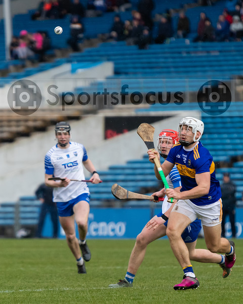 Tipperary's Niall O'Meara and Waterford's Darragh Lyons judge the flight of the sliotar