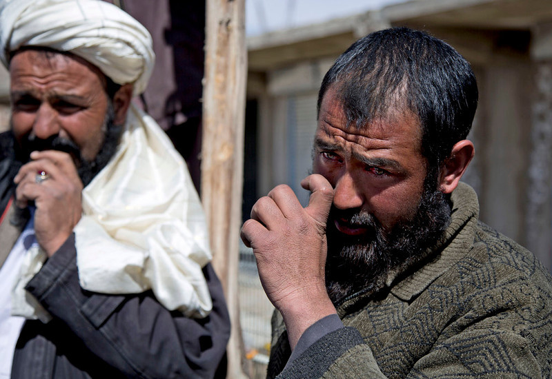 . Afghan carpenter Abdullah, right, wipes his tears away as he tells his story about an Afghan special forces solider who slammed the end of his rifle into Abdullah\'s neck causing a fracture in his vertebrae, in Maidan Shahr, Wardak province, Afghanistan, Sunday, March 10, 2013. Afghan President Hamid Karzai, infuriated by villager reports of forced detentions and mass arrests, gave U.S. Special Forces two weeks to vacate Wardak province, located barely 30 kilometers (24 miles) from the Afghan capital of Kabul. The deadline for their withdrawal expired midnight Sunday, March 10, 2013. (AP Photo/Anja Niedringhaus)