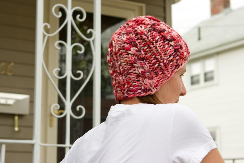 Squooshy pink hat, in Auracania Limari.