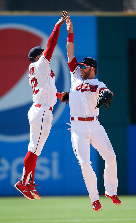 . Cleveland Indians\' Francisco Lindor (12) and Tyler Naquin celebrate a 5-2 victory over the New York Yankees in a baseball game, Sunday, July 15, 2018, in Cleveland. (AP Photo/Ron Schwane)
