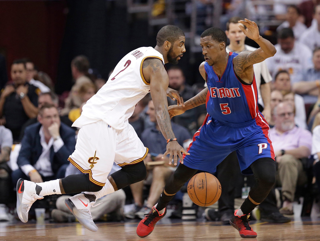 . Cleveland Cavaliers\' Kyrie Irving (2) drives past Detroit Pistons\' Kentavious Caldwell-Pope (5) in the first half in Game 2 of a first-round NBA basketball playoff series, Wednesday, April 20, 2016, in Cleveland. (AP Photo/Tony Dejak)