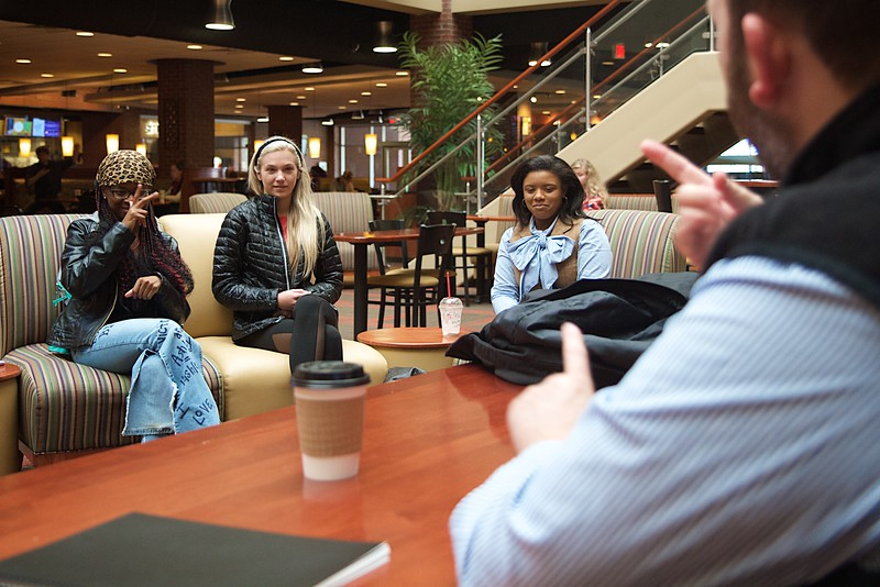 Students practicing ASL in the Tucker Student Center; Spring 2016.