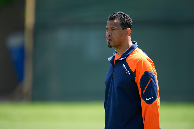 . Denver Broncos Minority Coaching Intern Rod Woodson looks on in drills during OTAs June 12, 2014 at Dove Valley. (Photo by John Leyba/The Denver Post)