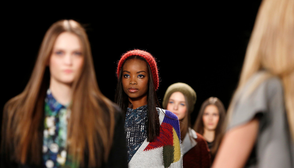 . Models present creations during the Rebecca Minkoff Fall 2013 show at New York Fashion Week in New York, February 8, 2013.  REUTERS/Carlo Allegri
