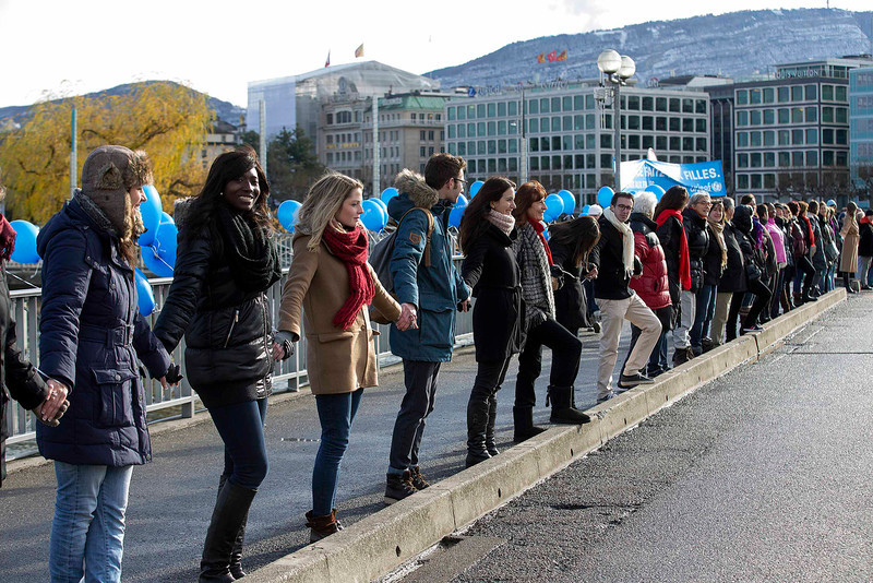 """. Called by UNICEF the demonstrators form a human chain on the occasion of the International Human Rights Day on the bridge \""""Pont des Bergues\"""", in Geneva, Switzerland, Monday, Dec. 10, 2012. (AP Photo/Keystone/Salvatore Di Nolfi)"""