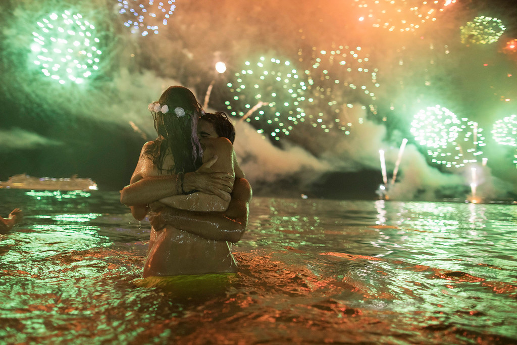 . A couple hug each other as they watch fireworks exploding over Copacabana beach during New Year\'s celebrations in Rio de Janeiro, Brazil, Monday, Jan. 1, 2018. (AP Photo/Leo Correa)