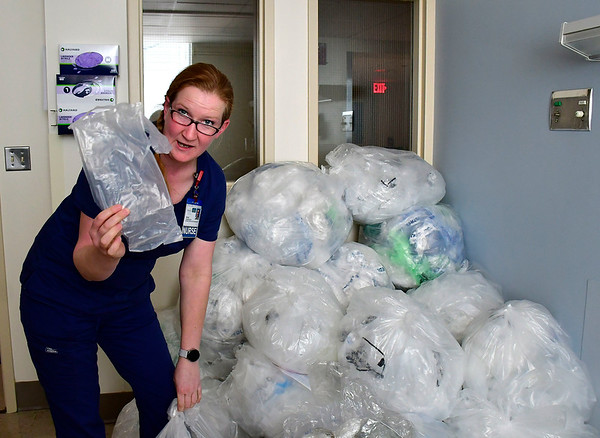 10/24/2019 Mike Orazzi | StaffrBristol Hospital Diana Comandini with some of the plastic she collected as part of a city program to save on trash and have a bench produced.