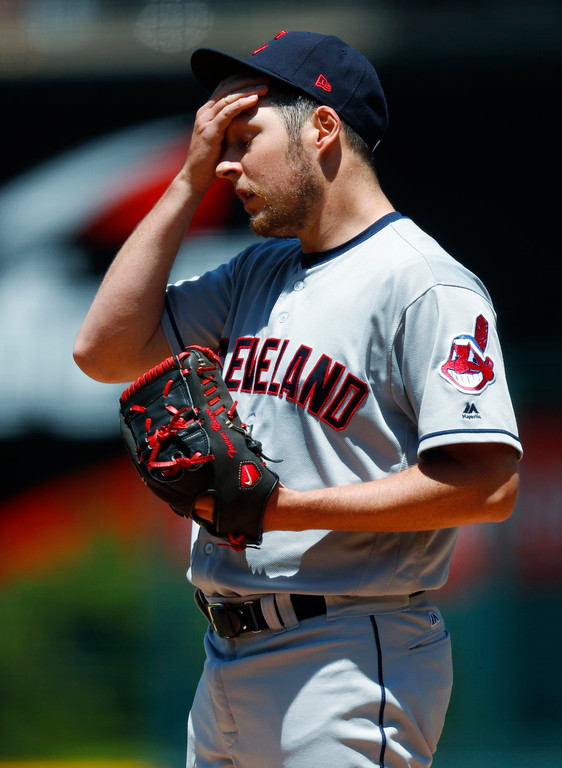 . Cleveland Indians starting pitcher Trevor Bauer deals with the hot, humid conditions as he takes the mound to face Colorado Rockies\' Charlie Blackmon in the first inning of an interleague baseball game Wednesday, June 7, 2017, in Denver. (AP Photo/David Zalubowski)