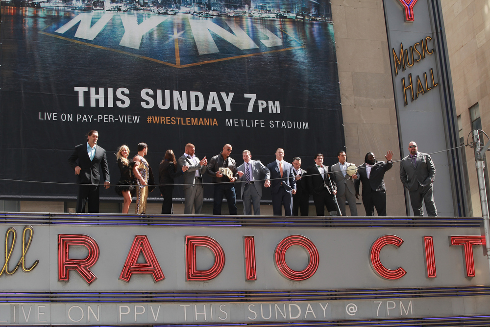 Description of . Wrestlers atop the marquee at WrestleMania 29 Press Conference at Radio City Music Hall on April 4, 2013 in New York City.  (Photo by Taylor Hill/Getty Images)