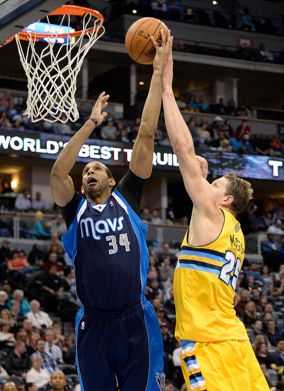 . Dallas Mavericks power forward Brandan Wright (34) gets his shot blocked by Denver Nuggets center Timofey Mozgov (25) March 5, 2014 at Pepsi Center. Denver Nuggets defeated the Dallas Mavericks 115-110. (Photo by John Leyba/The Denver Post)