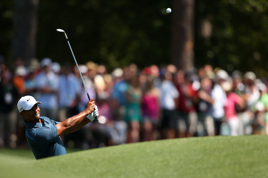 . AUGUSTA, GA - APRIL 13:  Tiger Woods of the United States chips onto the green on the eighth hole during the third round of the 2013 Masters Tournament at Augusta National Golf Club on April 13, 2013 in Augusta, Georgia.  (Photo by Mike Ehrmann/Getty Images)