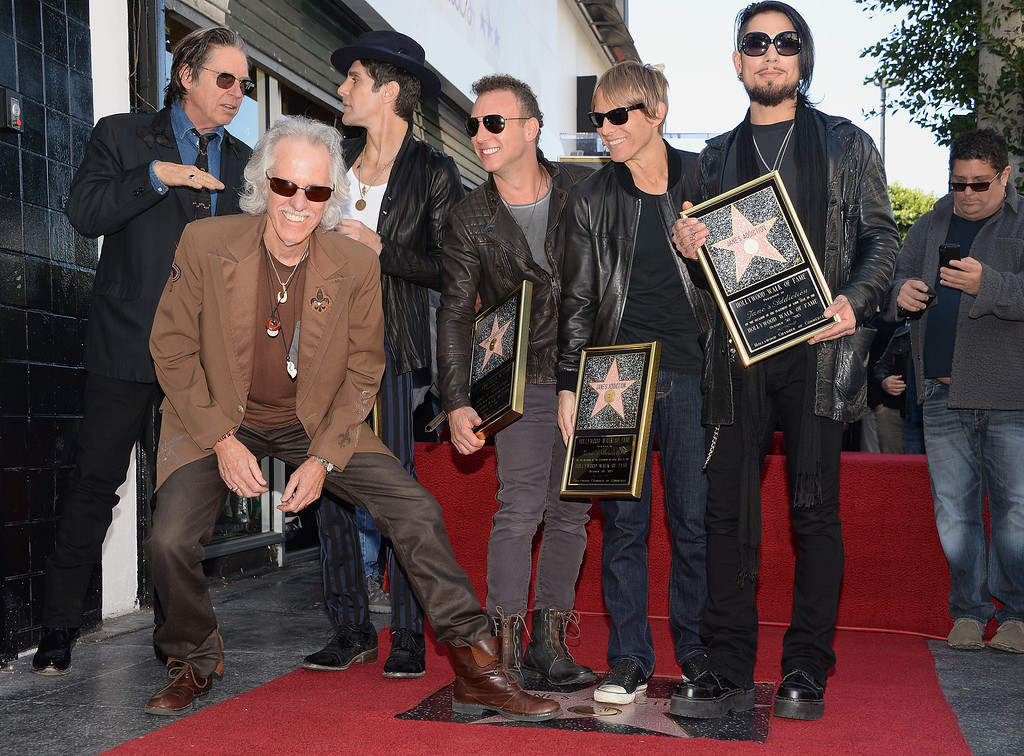 . John Densmore of The Doors (front left) and John Doe from X (back left) pose with, from left, Perry Farrell, Stephen Perkins, Chris Chaney and Dave Navarro of the alt-rock band Jane\'s Addiction at the ceremony honoring the band with a star on The Hollywood Walk of Fame, October 30, 2013 in Hollywood, California.          (ROBYN BECK/AFP/Getty Images)