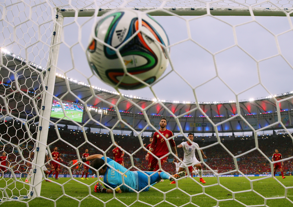. Charles Aranguiz of Chile (not pictured) scores the second goal past Iker Casillas of Spain during the 2014 FIFA World Cup Brazil Group B match between Spain and Chile at Maracana on June 18, 2014 in Rio de Janeiro, Brazil.  (Photo by Clive Rose/REMOTE/Getty Images)