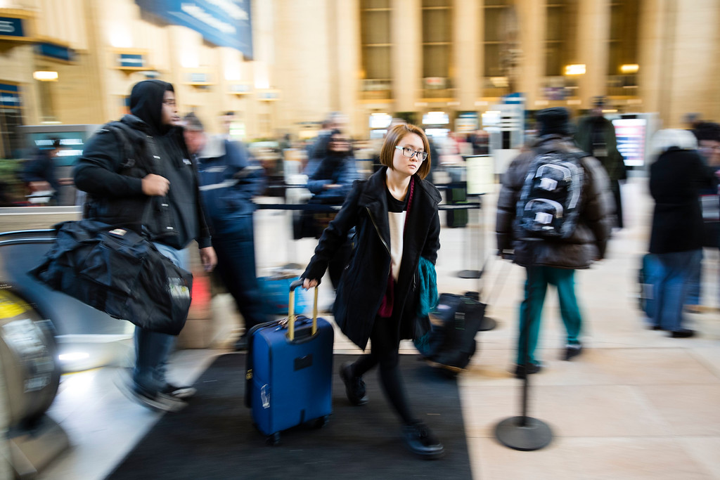 . Travelers make their way through the 30th Street Station for the Thanksgiving Day holiday, in Philadelphia, Tuesday, Nov. 22, 2016. Almost 49 million people are expected to travel 50 miles or more for the holiday, the most since 2007, according to AAA.  (AP Photo/Matt Rourke)