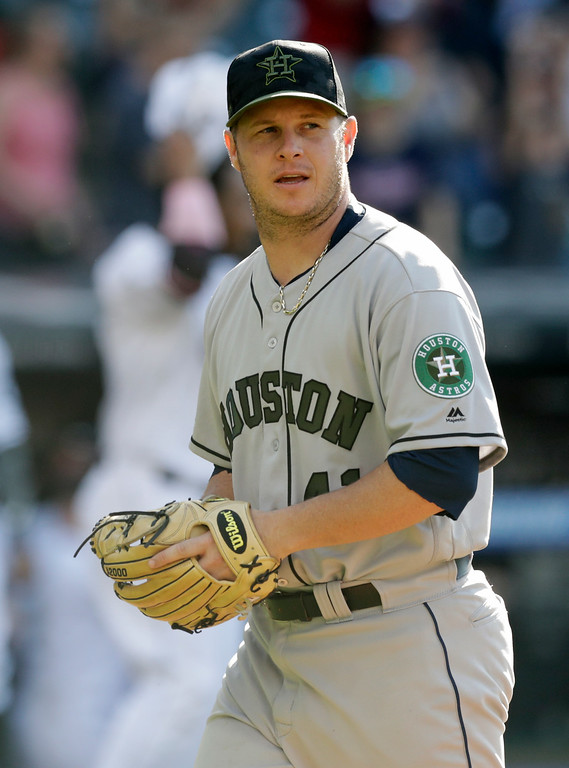 . Houston Astros relief pitcher Brad Peacock walks off the field after giving up a winning solo home run to Cleveland Indians\' Greg Allen in the 14th inning of a baseball game, Sunday, May 27, 2018, in Cleveland. (AP Photo/Tony Dejak)
