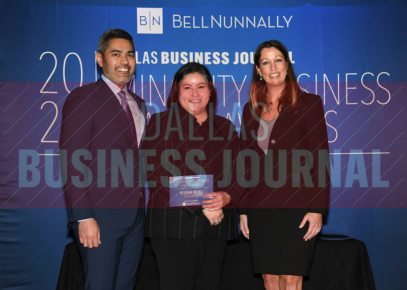 Yesenia Reyes, Managing Director, Accenture LLP, (center) accepts her Minority Business Leader award from Chandhok, (left) and Mathes.