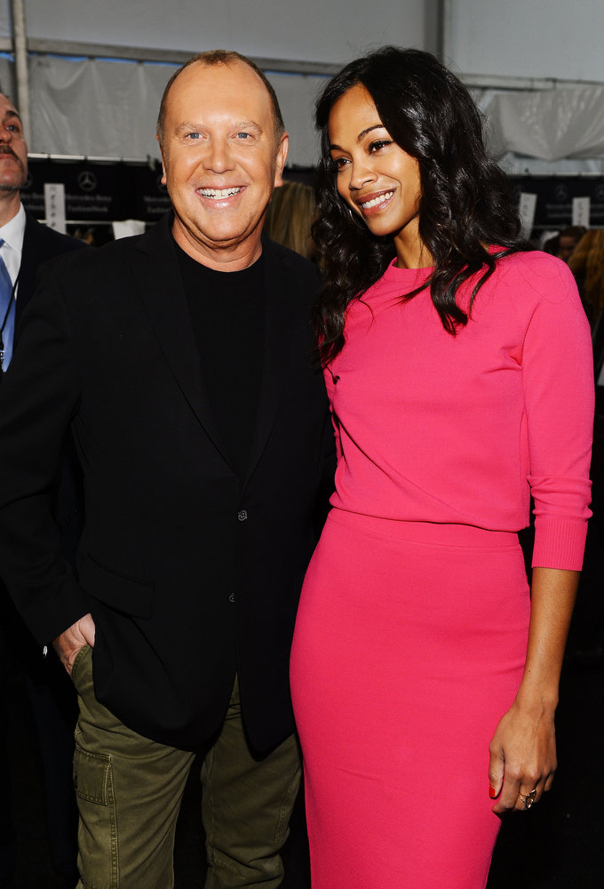 Description of . Designer Michael Kors and actress Zoe Saldana pose backstage at the Michael Kors Fall 2013 fashion show during Mercedes-Benz Fashion Week at The Theatre at Lincoln Center on February 13, 2013 in New York City.  (Photo by Dimitrios Kambouris/Getty Images for Michael Kors)