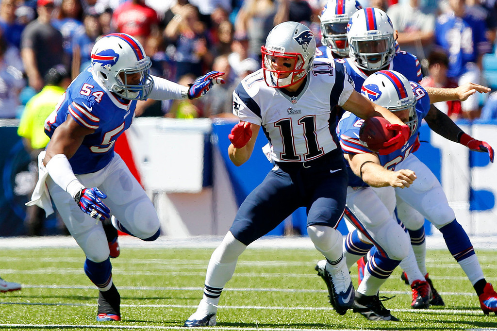 . New England Patriots\' Julian Edelman (11) returns a punt as Buffalo Bills\' Marcus Dowtin (54) attempts to tackle him during the first half of an NFL football game on Sunday, Sept. 8, 2013, in Orchard Park. (AP Photo/Bill Wippert)