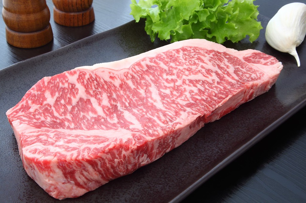 A slab of beautifully marbled Kobe beef