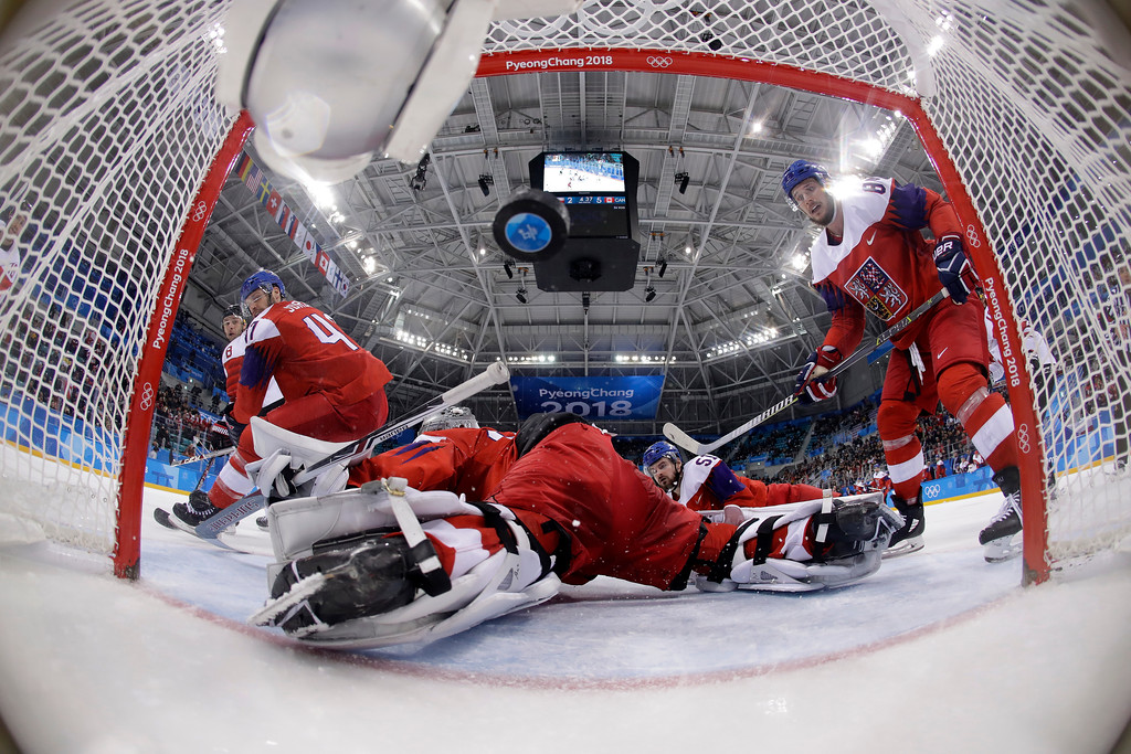. Wojtek Wolski (8), of Canada, shoots a goal past goalie Pavel Francouz (33), of the Czech Republic, during the third period of the men\'s bronze medal hockey game at the 2018 Winter Olympics in Gangneung, South Korea, Sunday, Feb. 25, 2018. (AP Photo/Matt Slocum, Pool)