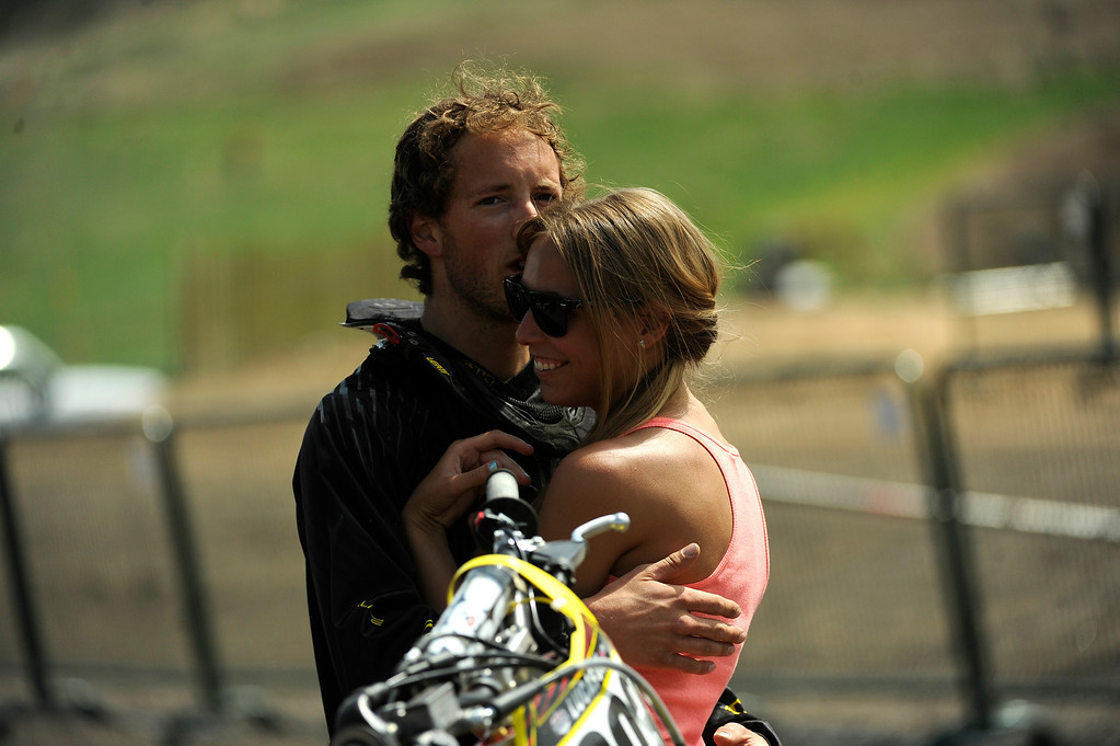 . Lakewood, CO. - MAY 23: #765 Mike Giese of Sedalia, Colo., hugs his girlfriend Krystin Nolin of Littleton Colo., as he whats to for his practice laps during a media day at the Thunder Valley Motocross Park in Lakewood, Colo. May 23, 2013. The practice was part of a media day event promoting coverage for the 2013 AMA Thunder Valley National the next day. (Photo By Manuel J. Martinez/The Denver Post)