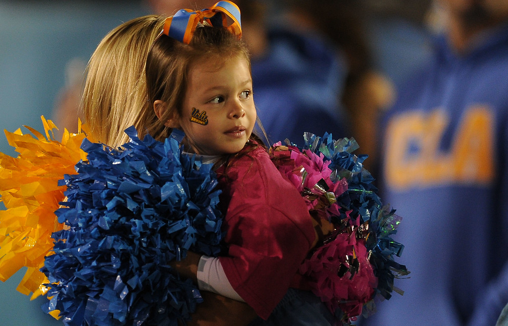 . A young UCLA cheerleader prior to their college football game against California in the Rose Bowl in Pasadena, Calif., on Saturday, Oct. 12, 2013.   (Keith Birmingham Pasadena Star-News)