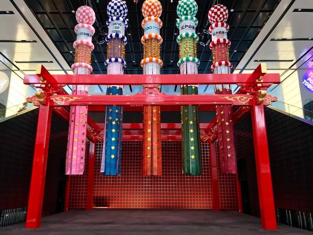 Colourful streamers decorate the center stage at Edo Market.