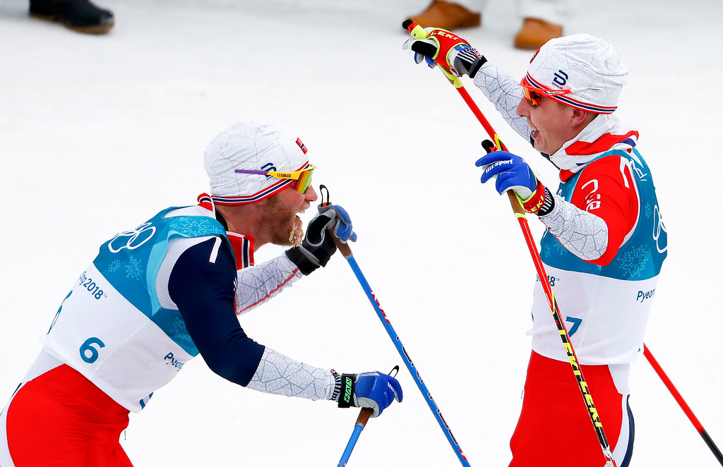 . Gold Medal winner Simen Hegstad Krueger, of Norway, right, celebrates with silver medalist Martin Johnsrud Sundby, of Norway, after the men\'s 15km/15km skiathlon cross-country skiing competition at the 2018 Winter Olympics in Pyeongchang, South Korea, Sunday, Feb. 11, 2018. (AP Photo/Matthias Schrader)