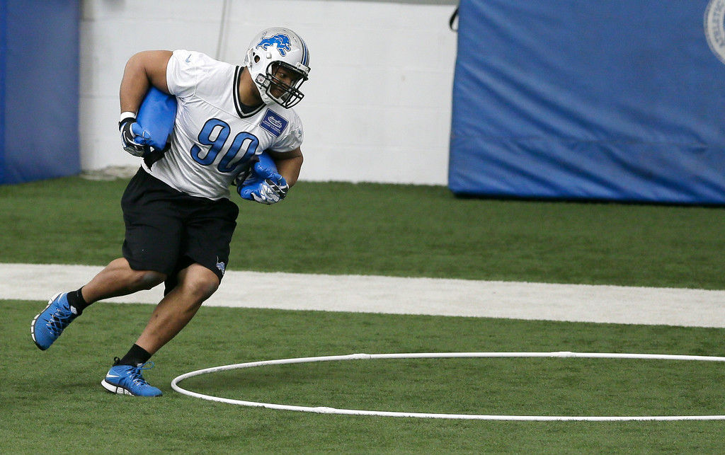 . Detroit Lions defensive tackle Ndamukong Suh runs through drills during organized team activities at the Lions training camp facility in Allen Park, Mich., Wednesday, May 21, 2014. (AP Photo/Carlos Osorio)