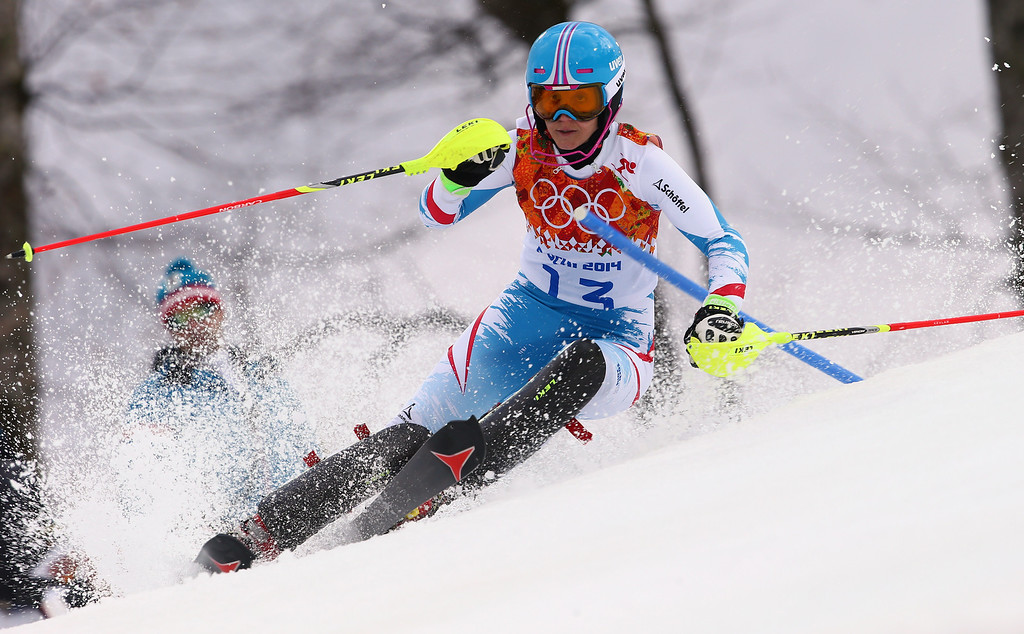 . Austria\'s Michaela Kirchgasser skis past a gate in the first run of the women\'s slalom at the Sochi 2014 Winter Olympics, Friday, Feb. 21, 2014, in Krasnaya Polyana, Russia. (AP Photo/Alessandro Trovati)