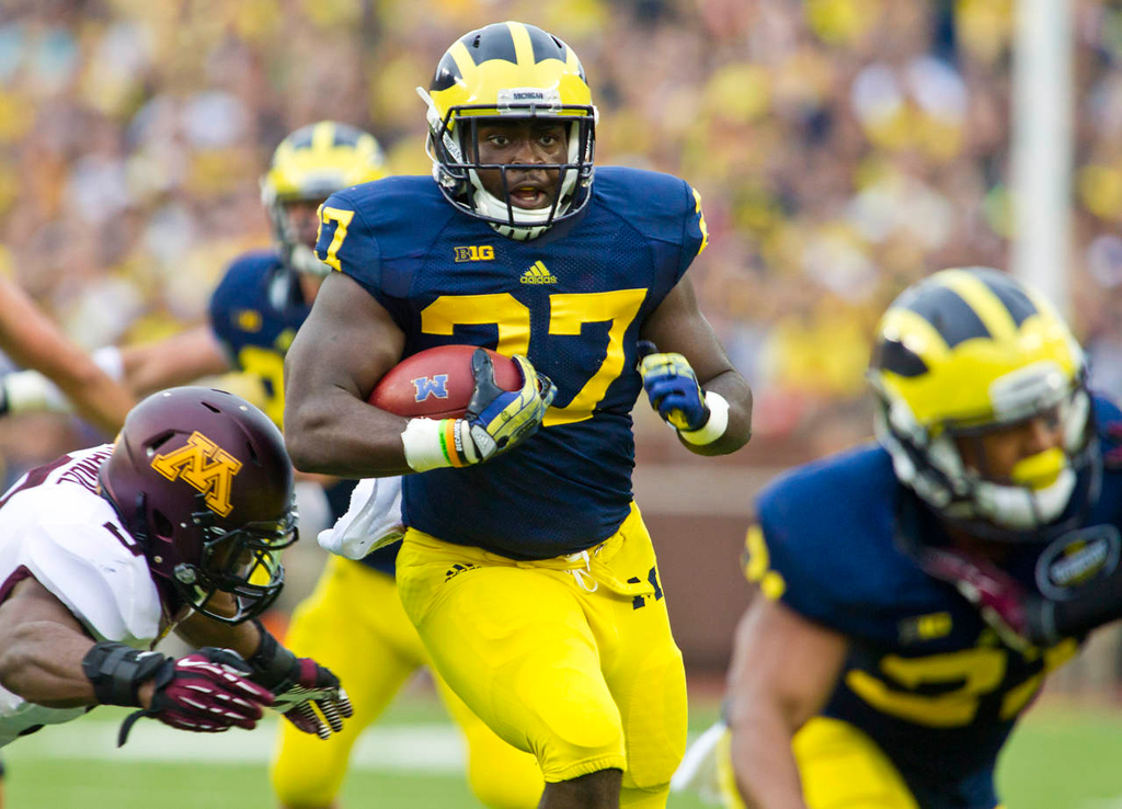 . Michigan running back Derrick Green  rushes in the first quarter. (AP Photo/Tony Ding)