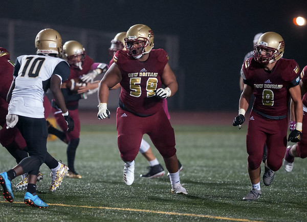 11/02/18 Wesley Bunnell | Staff New Britain football vs East Hartford at Veterans Stadium on Friday night. Devon Bishop (59) and Robert Zapor III (8) provide blocking for the ball carrier.
