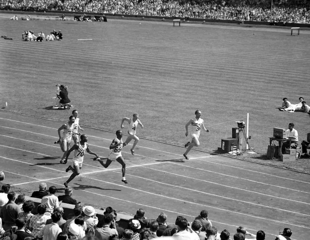 . America\'s Harrison Dillard, second left front, wins the 100-metre Olympic Games semi-final at Wembley Stadium, London, July 31, 1948. America\'s Barney Ewell, front left, was second and Britain\'s Alastair McCorquodal, far right, was third. (AP Photo)