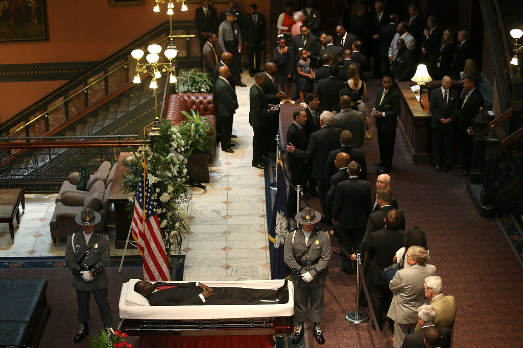 . Visitors pay their respects during an open viewing for Rev. Clementa Pinckney at the South Carolina State House June 24, 2015 in Columbia, South Carolina. Pinckney was one of nine people killed during a Bible study inside Emanuel AME church in Charleston. U.S. President Barack Obama and Vice President Joe Biden are expected to attend the funeral which is set for Friday June 26 at the TD Arena.  (Photo by Joe Raedle/Getty Images)