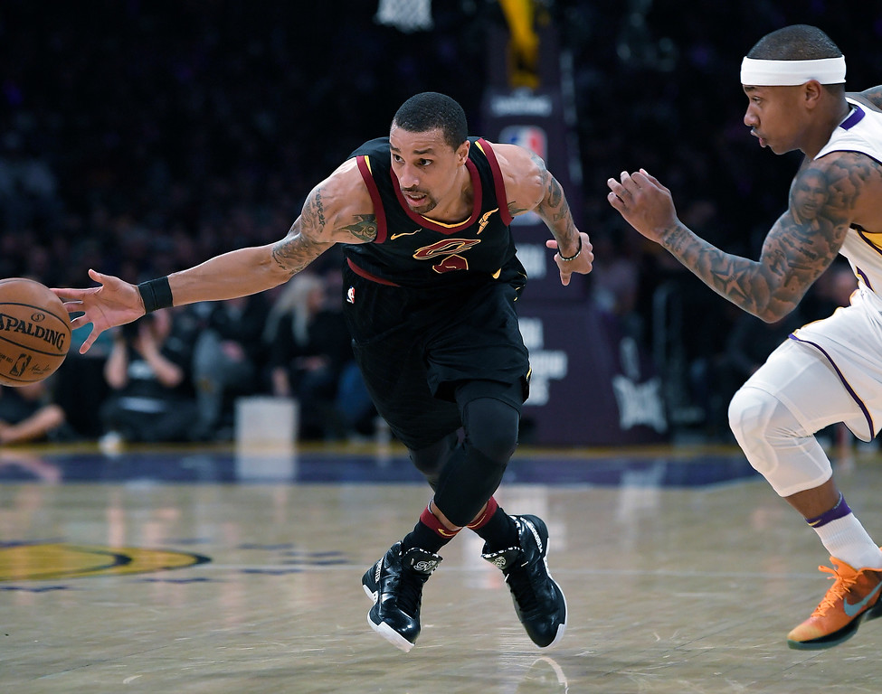 . Cleveland Cavaliers guard George Hill, drives past Los Angeles Lakers guard Isaiah Thomas during the first half of an NBA basketball game, Sunday, March 11, 2018, in Los Angeles. (AP Photo/Mark J. Terrill)