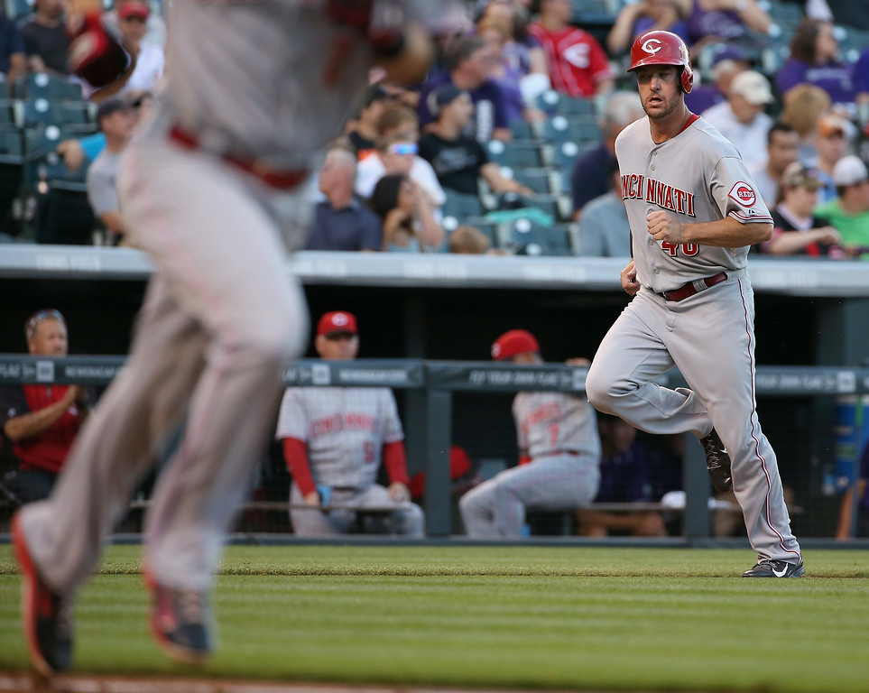 . DENVER, CO - AUGUST 14:  Ryan Ludwick #48 of the Cincinnati Reds heads home to score on a single by Zack Cozart #2 of the Cincinnati Reds to give the Reds a 2-0 lead over the Colorado Rockies in the second inning at Coors Field on August 14, 2014 in Denver, Colorado.  (Photo by Doug Pensinger/Getty Images)