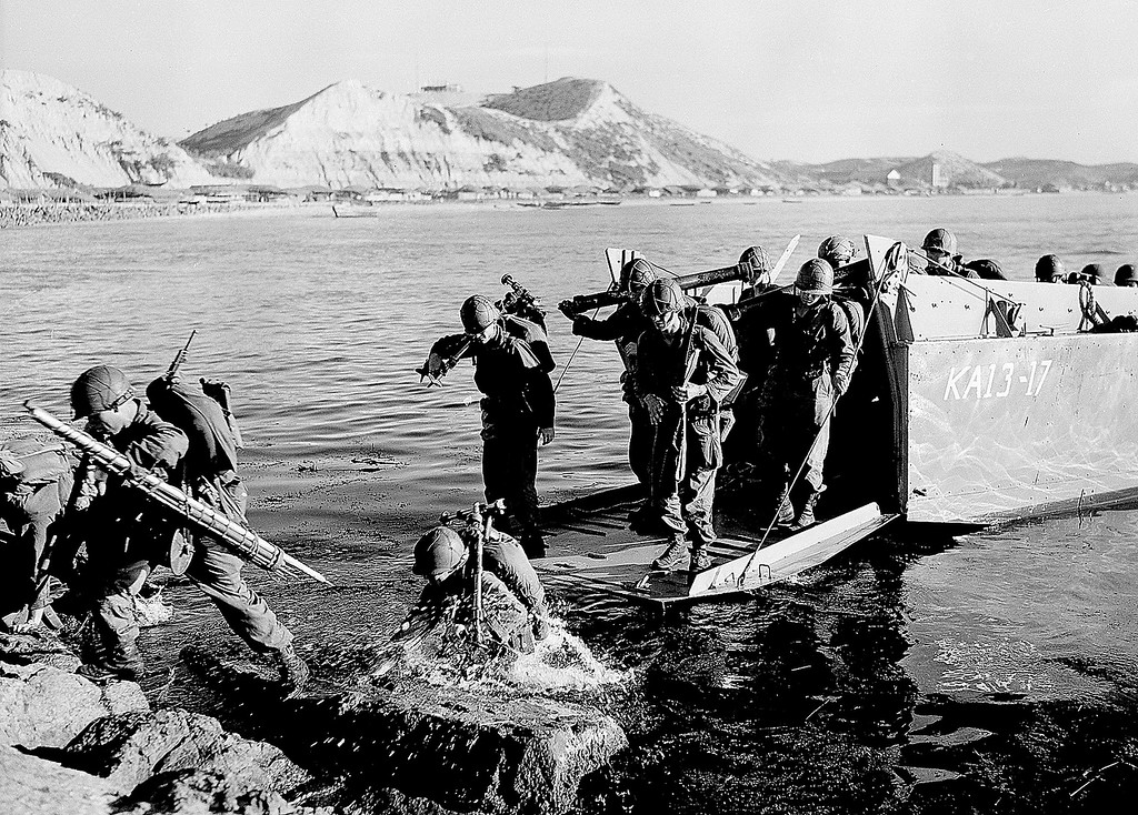 ". Troops of the First U.S. Cavalry Division land ashore at Pohang on the east coast of Korea during the Korean War.  This is the first combat amphibious operation since World War II.  The war that began in Korea 60 years ago, on June 25, 1950, a ghastly conflict that killed millions and left the peninsula in ruins, became ""The Forgotten War\"" in many American minds. (AP Photo)"