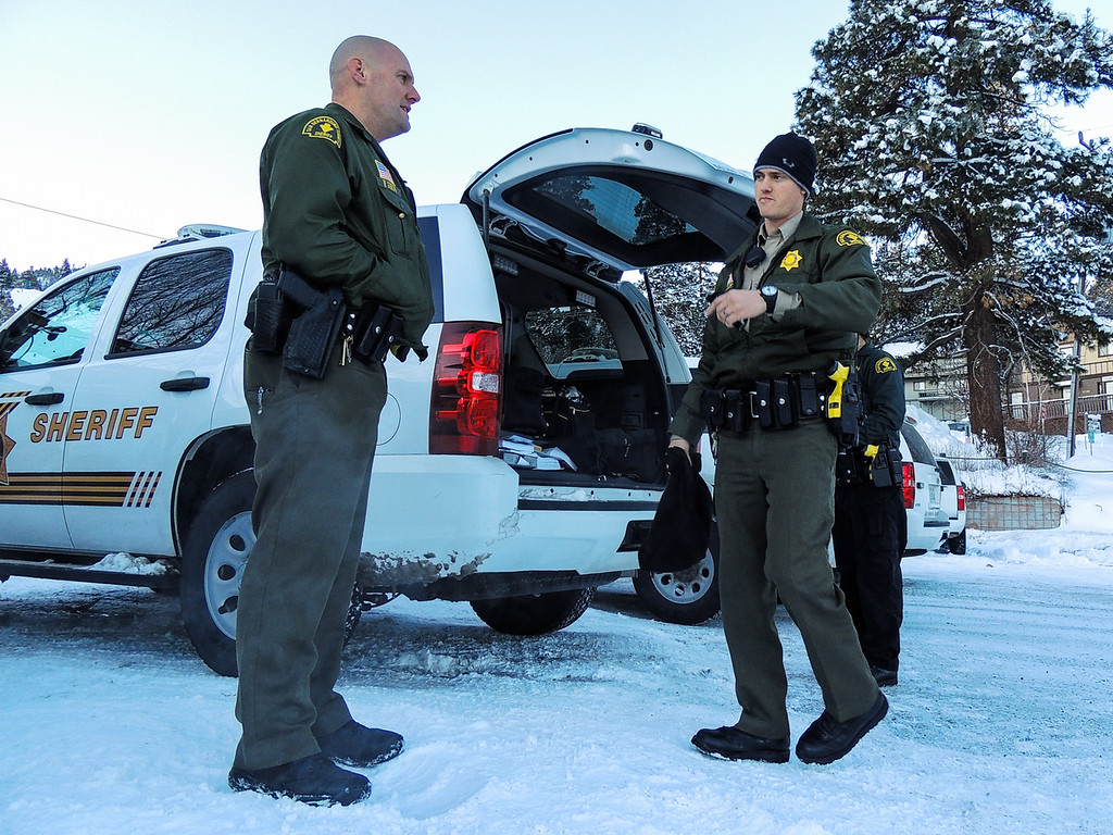 . Sheriff\'s deputies complete their shift and return to the command post at Bear Mountain Resort at start of day four in the search for fugitive ex-cop Christopher Dorner in Big Bear on Sunday, Feb. 10, 2013. (Rachel Luna / Staff Photographer)