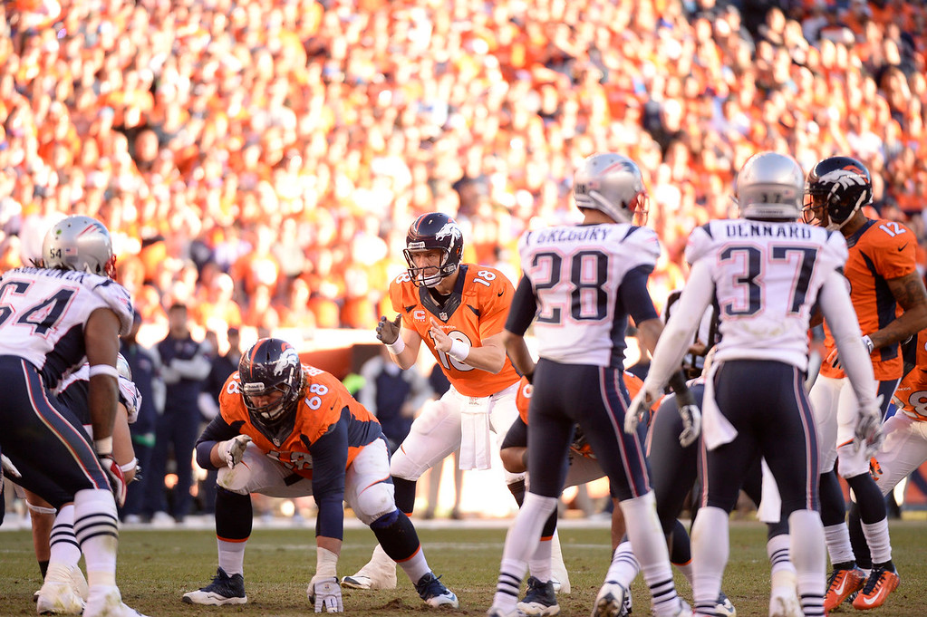 . Denver Broncos quarterback Peyton Manning (18) runs the offense during the fourth quarter. The Denver Broncos vs. The New England Patriots in an AFC Championship game  at Sports Authority Field at Mile High in Denver on January 19, 2014. (Photo by John Leyba/The Denver Post)