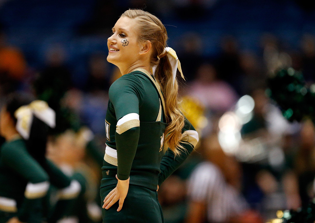 . A Cal Poly Mustangs cheerleader performs during the first round of the 2014 NCAA Men\'s Basketball Tournament against the Texas Southern Tigers at UD Arena on March 19, 2014 in Dayton, Ohio.  (Photo by Gregory Shamus/Getty Images)
