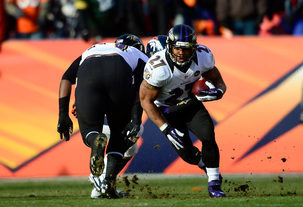 Description of . Baltimore Ravens running back Ray Rice (27) runs the ball for a small gain in the first quarter. The Denver Broncos vs Baltimore Ravens AFC Divisional playoff game at Sports Authority Field Saturday January 12, 2013. (Photo by AAron  Ontiveroz,/The Denver Post)