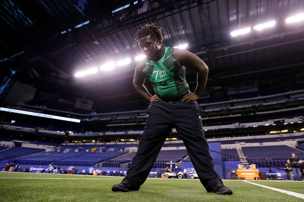 . Texas defensive lineman Malcom Brown stretches before drills at the NFL football scouting combine in Indianapolis, Sunday, Feb. 22, 2015. (AP Photo/Julio Cortez)