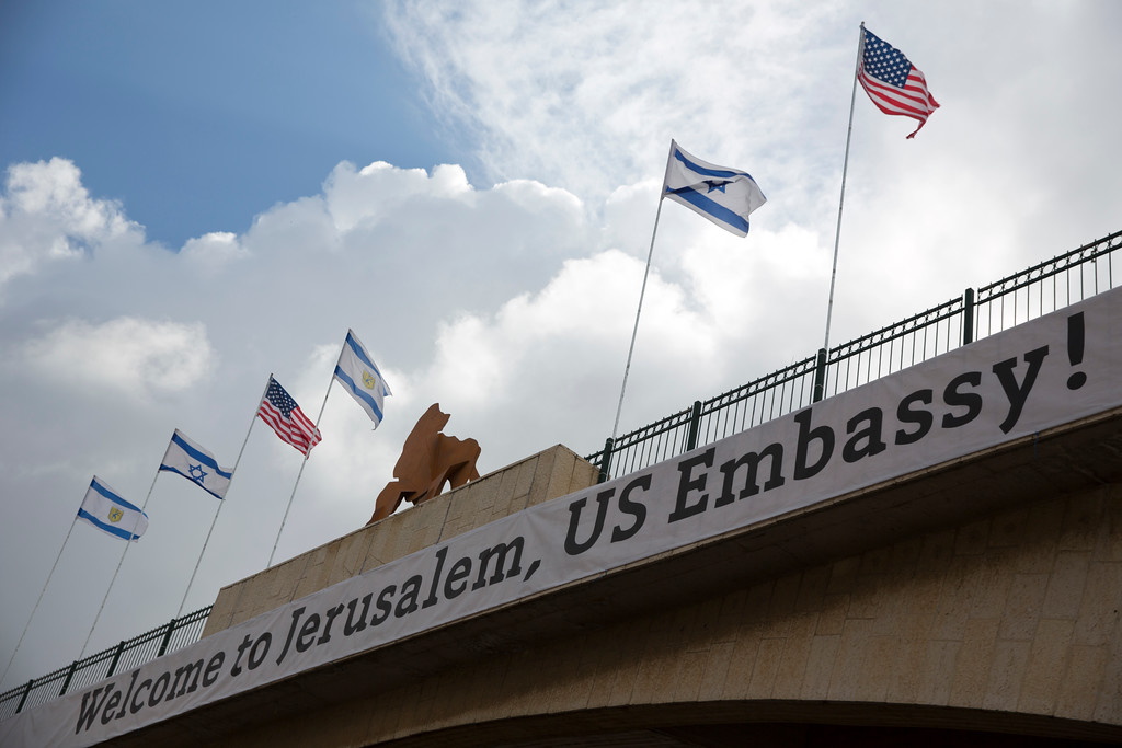 . A sign on a bridge leading to the US Embassy compound ahead the official opening in Jerusalem, Sunday, May 13, 2018. Monday\'s opening of the U.S. Embassy in contested Jerusalem, cheered by Israelis as a historic validation, is seen by Palestinians as an in-your-face affirmation of pro-Israel bias by President Donald Trump and a new blow to frail statehood dreams. (AP Photo/Ariel Schalit)