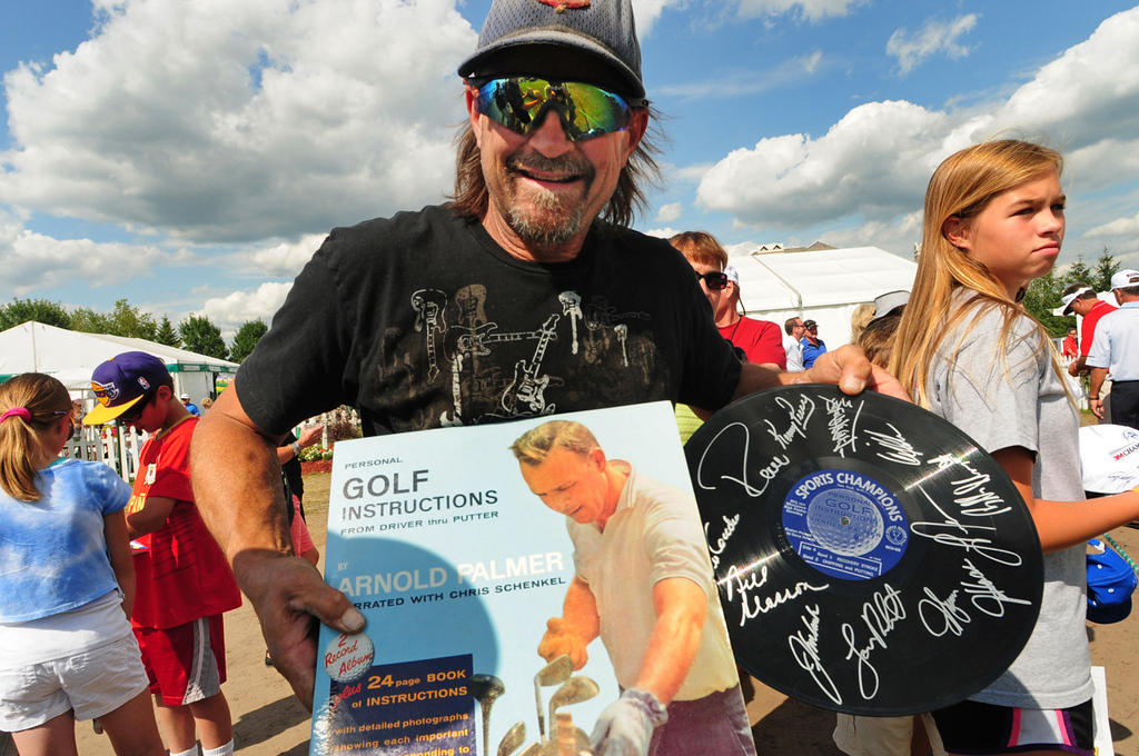 ". Golf fanatic Randy Becker of Lincoln, Neb. grins after adding Jay Haas\'s autograph to his Arnold Palmer ""Personal Golf Instructions\"" album on the final day of the 3M Championship. (Pioneer Press: Scott Takushi)"