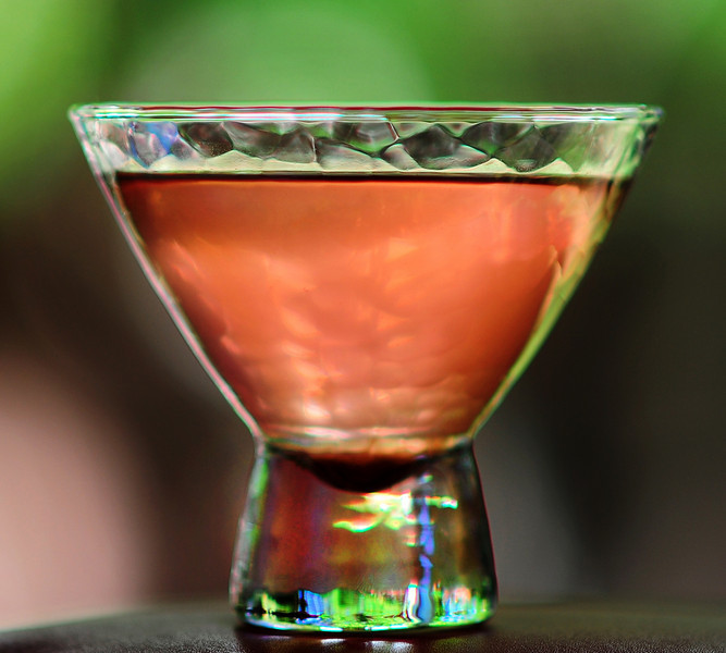 """Photograph of """"Pink Amanda Martini"""" made with iS Vodka especially for Amanda Lepore. A """"Pink Amanda Martini"""" is made with iS Vodka, Sprite, Fresh Limejuice, and a Dash of Organic Berry Juice for color. IS Vodka http://www.isvodka.com is a super-pure, ulta-premium vodka distilled 7 times, mixed with glacier water from the land of ice and snow - Iceland."""