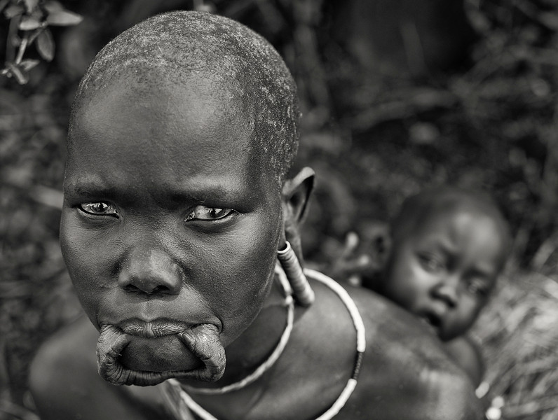 This is Vilori and her baby from the mursi tribe.   Omo Valley, Southern Ethiopia, 2013.