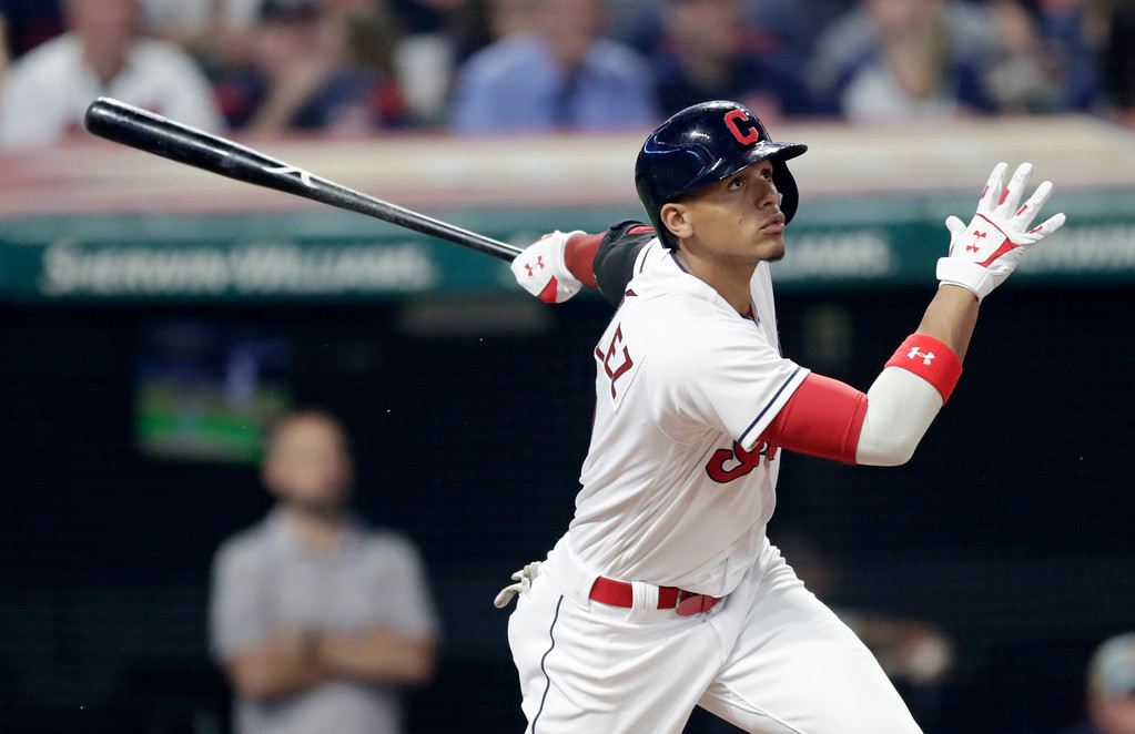 . Cleveland Indians\' Erik Gonzalez watches his RBI double off Minnesota Twins relief pitcher Taylor Rogers in the ninth inning of a baseball game, Friday, June 15, 2018, in Cleveland. The Twins won 6-3. (AP Photo/Tony Dejak)