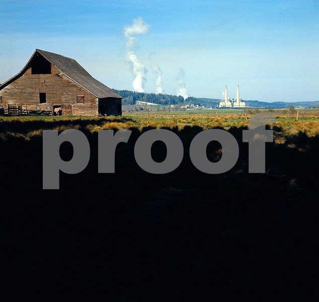 Centralia Steam Electric Plant 1977-1:The TransAlta (Canadian owned) plant emits 10% of the state's greenhouse gas-emissions. It ranks 125th in the nation for mercury pollution. It emits 10.5 million tons of CO2 annually. Photo taken in 1977. What this photo is saying is that the barn door was closed after the horse was out....an environmental comment.